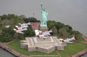 The GEICO Skytypers fly over The Statue of Liberty. Photo Scott Snorteland