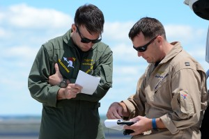MacGruber and Bearshark briefing the maneuvers.