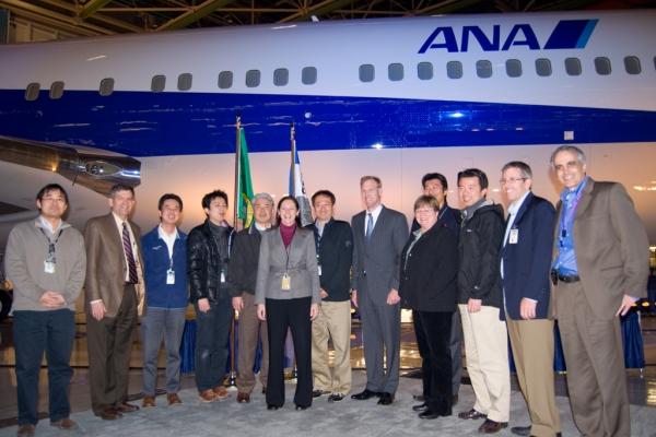 Kim Pastega with representatives of ANA in front of the plane.