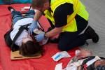 A rescuer treats a victim.
