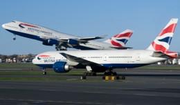 British Airways Boeing 747 and 777s cross paths at Boston's Logan International Airport. (Photo by Eric Dunetz)