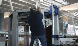 A technician assembles a brand new TSA body scanner. (Photo by Matt Molnar/NYCAviation)